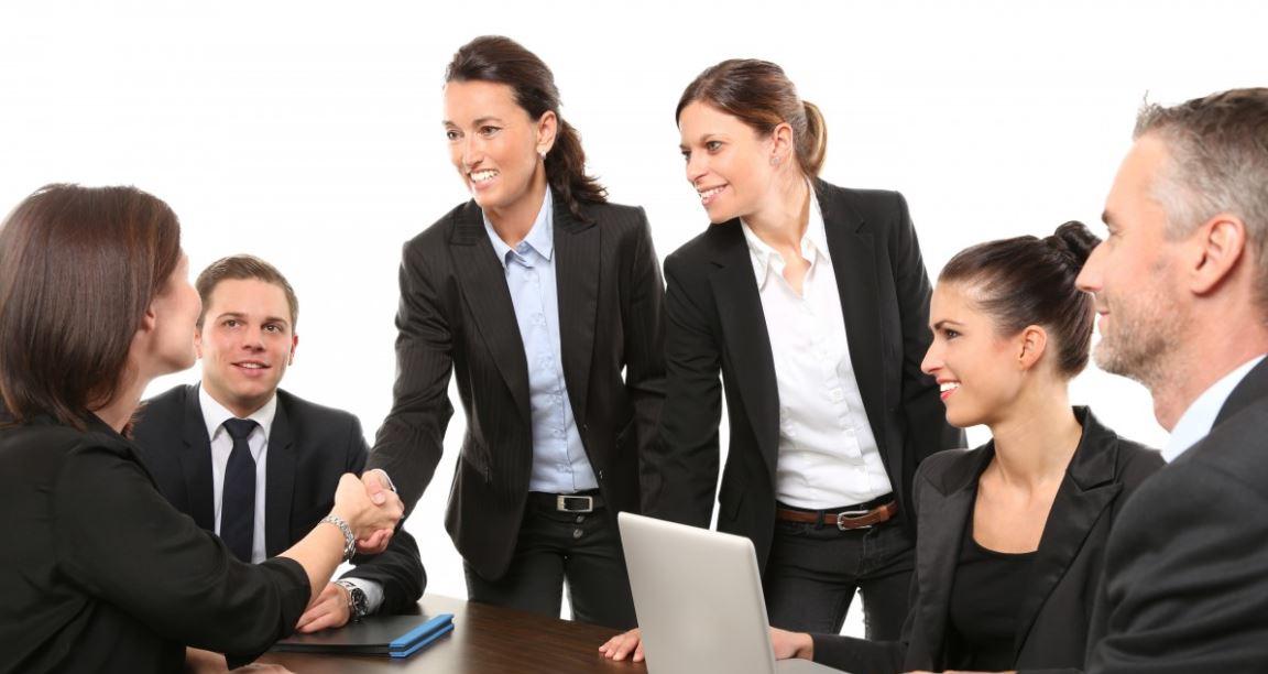 Women in suits shaking hands