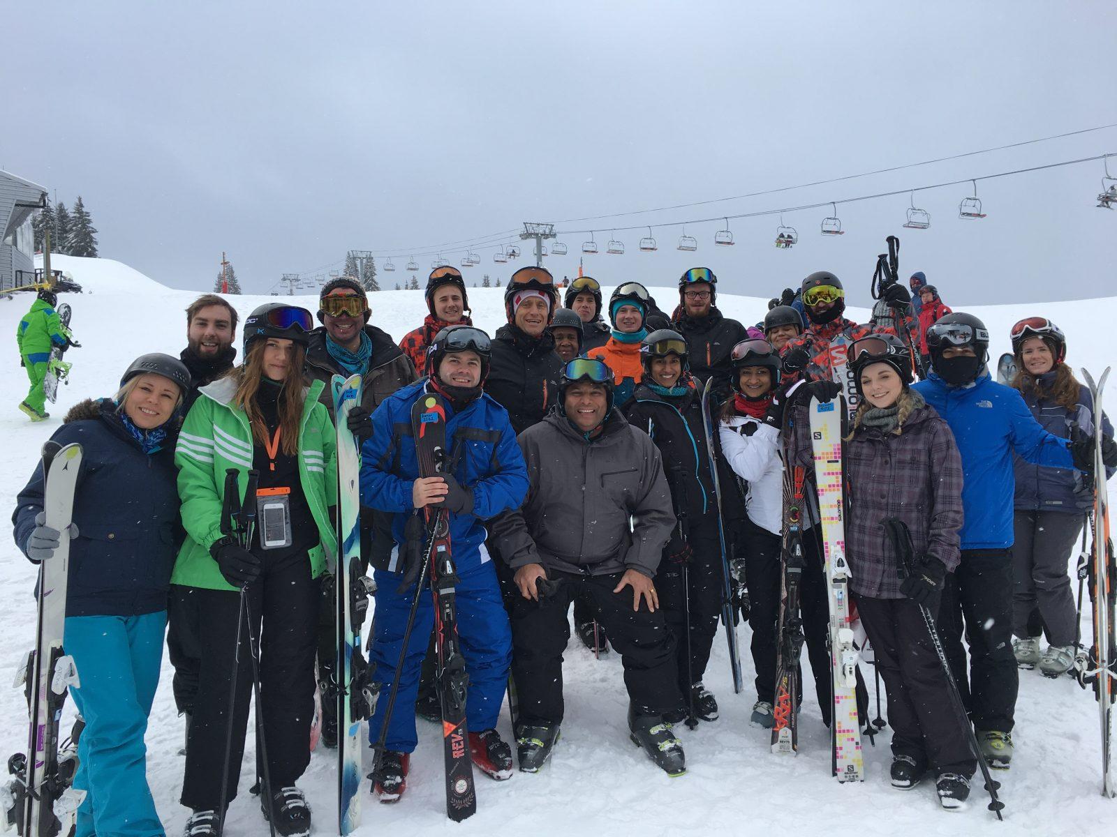 Corporate peaks group on a ski mountain
