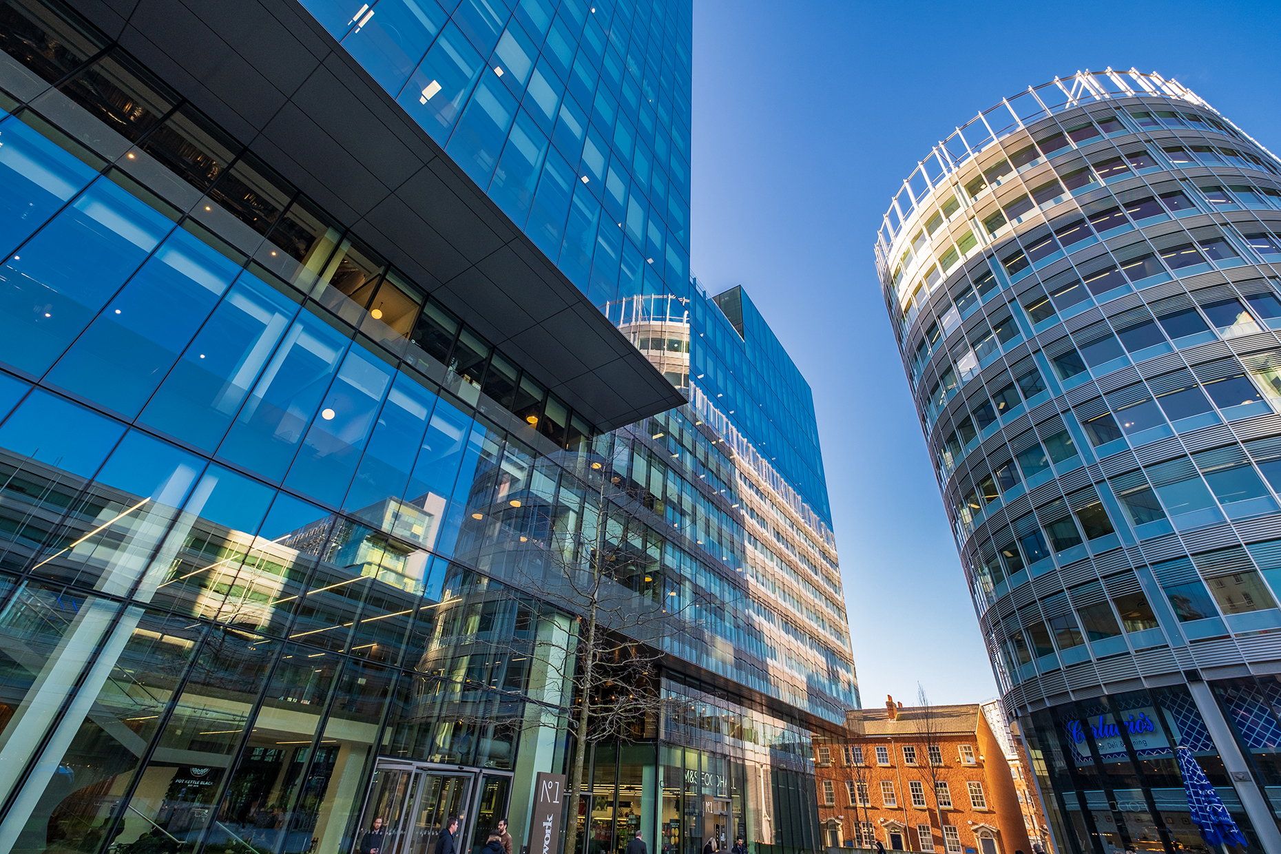 Manchester, United Kingdom - November 29, 2019: Street view of Spinningfields, a modern area was specially developed in the 2000s as a business, retail and residential development of Manchester.