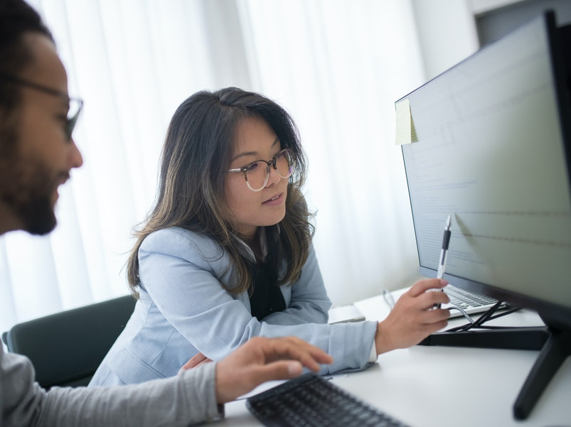 Woman pointing to computer